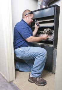 Technician looking at a furnace