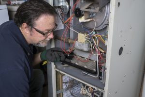 Technician working on furnace